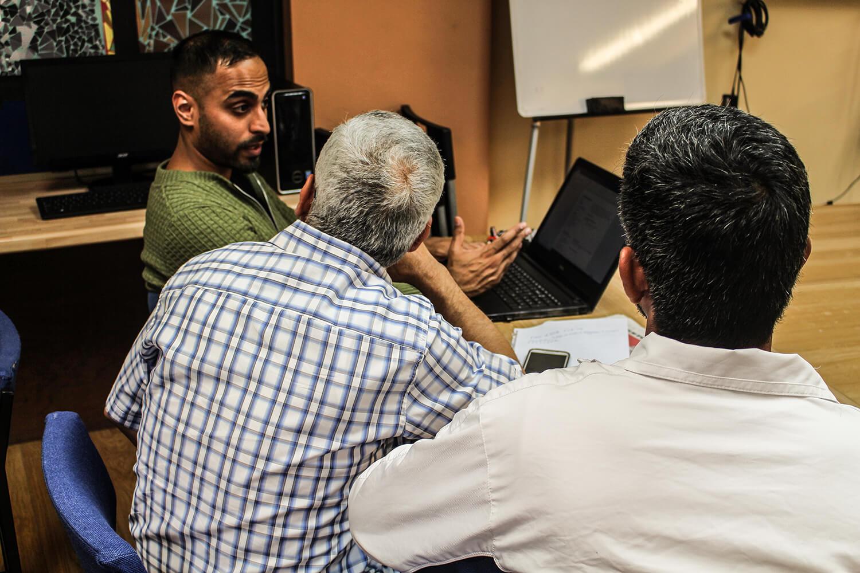 men at a meeting